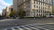 Shot of people and cars going down 5th Avenue in Manhattan, New York City on a fall day