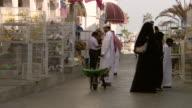 MS Shot of people at birds market / Doha Qatar
