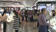 Shot of people at cosmetic counter in duty free shop of Incheon International Airport