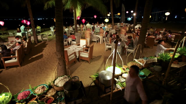 MS T/L Shot of People being serving dinner at buffet at Ana Mandara Resort  / Nha Trang, Khanh Hoa, Vietnam