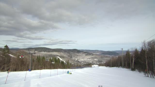 WS Shot of people enjoying at Generic skiing slope / Quebec, Canada