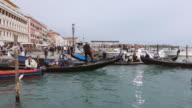 WS Shot of people enjoying in gondolas at Molo Riva degli Schiavoni / Venice, Veneto, Italy