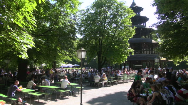 WS Shot of people enjoying their beer in garden at Chinese tower in English Garden / Munich, Bavaria, Germany