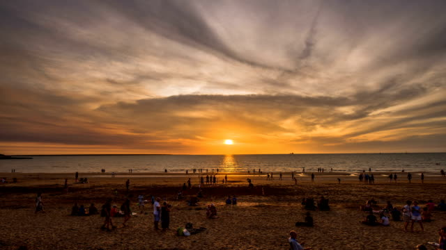 Shot of people enjoying their vacation at a beach in Darwin