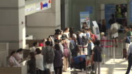 Shot of people in a row at the roaming center of Incheon International Airport