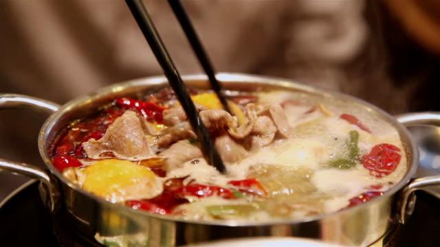 CU Shot of people in restaurant to eat hot pot / Xian, China