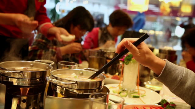 MS Shot of people in restaurant to eat hot pot / Xian, China