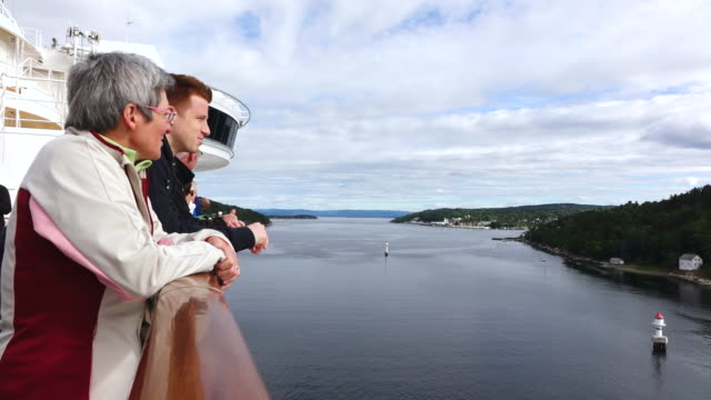 MS Shot of People looking at nature in Ferry ship at skerry coast in Oslofjord / Oslo, Norway
