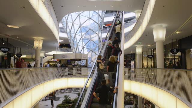 MS Shot of people on escalator in modern shopping centre, My Zeil / Frankfurt am Main, Hesse, Germany