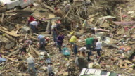 MS AERIAL Shot of people picking through debris / Smithville, Mississippi, United States