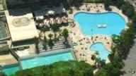 MS AERIAL TS Shot of People swim in Swimming pool / Sao Paulo, Brazil