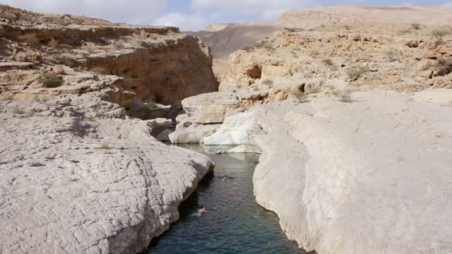 MS Shot of People swimming in Wadi Bani Khalid / Wadi Bani Khalid, Oman