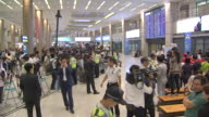 Shot of people waiting at entry place in Incheon International Airport