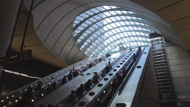 MS Shot of people waliking through Escalator at Canary Wharf London / London, United Kingdom