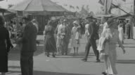 WS Shot of people walking about on fairgrounds
