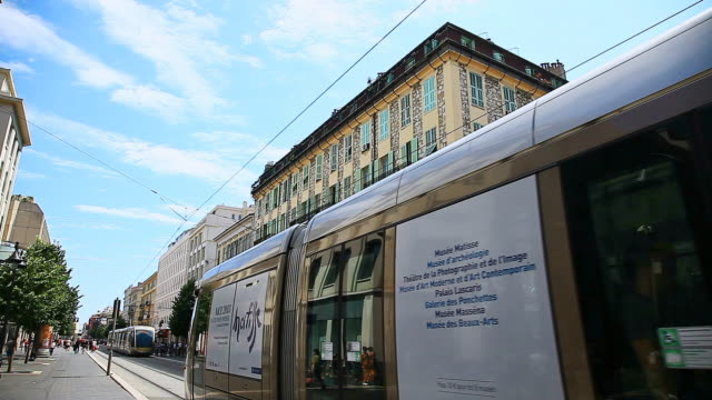 MS Shot of people walking and tram passing through downtown / Nice, Provence Alpes Cote d'Azur, France