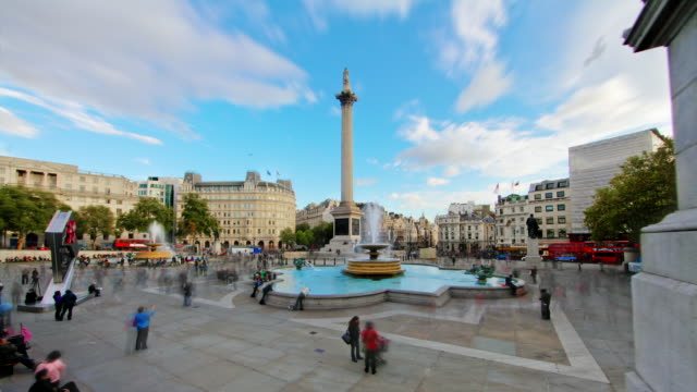 MS T/L Shot of People walking around trafalgar square / London, United Kingdom