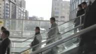 MS POV shot of People walking at escalato/ Tokyo, Greater Tokyo, Japan