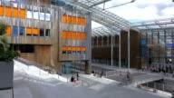 MS Shot of People walking at Modern buildings at Aker Brygge / Oslo, Norway