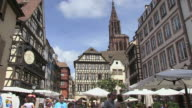 MS Shot of people walking at Old town Petite France, Rue du Maroquin / Strasbourg, Alsace, France