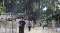 MS Shot of People walking in fishing village / Ngapali, Rakhine State, Myanmar