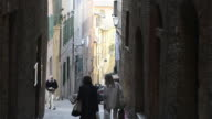 MS Shot of people walking in old town lane / Siena, Tuscany, Italy