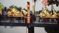 MS Shot of people walking on Bridge / Hoi An, Quang Nam, Vietnam