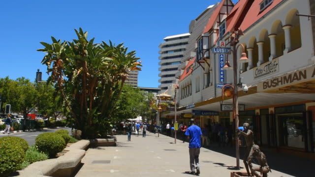 MS Shot of people walking on Independence Avenue downtown in Capitol city clean and active / Windhoek, Namibia, South Africa