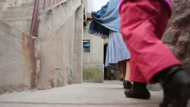 Shot of people walking with child / Potosi Bolivia