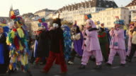 WS PAN Shot of people with mask and dressing up celebrating Basler Fasnacht (Basel Carnival) on street / Basel, Switzerland