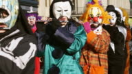 CU Shot of people with mask and dressing up playing flute at celebrating Basler Fasnacht (Basel Carnival) on street / Basel, Switzerland