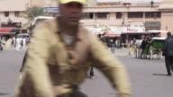 MS PAN Shot of peoples walking on street and market place at Djemaa El Fnaa / Marrakesh, Morocco