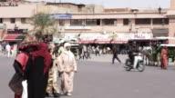 MS PAN Shot of peoples walking on street with buggy moving at Djemaa El Fnaa / Marrakesh, Morocco