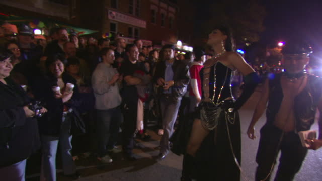 WS TS Shot of person in dominatrix costume struts through high heel race in DuPont Circle / Washington, Dist. of Columbia, United States