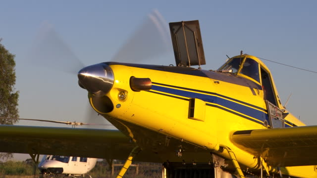CU Shot of Plane prop spinning sitting on runway / Melbourne, Australia