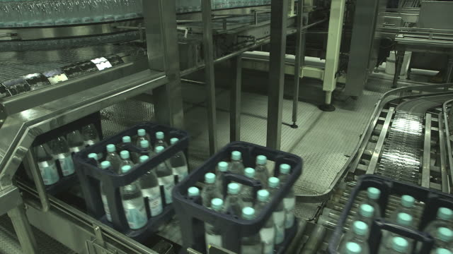 MS Shot of Plastic bottle in carret moving inbottling plant at beverage industry / Gerolstein, Rhineland Palatinate, Germany
