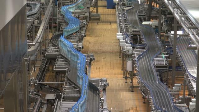 MS Shot of plastic bottle moving in bottling plant at beverage industry / Gerolstein, Rhineland Palatinate, Germany