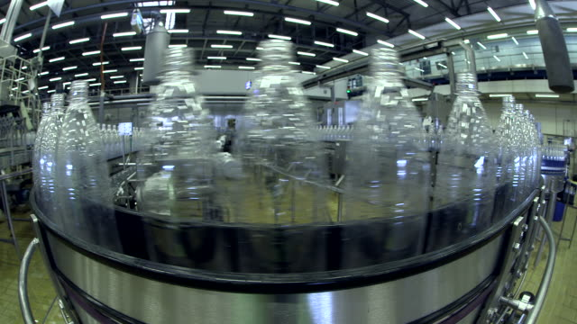 CU Shot of Plastic bottle moving in bottling plant at beverage industry / Gerolstein, Rhineland Palatinate, Germany