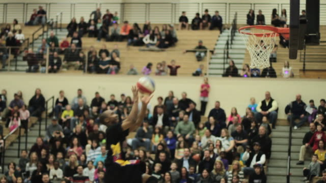 CU SLO MO Shot of Player bounces ball off of backboard to another player who dunks ball / Monroe, New York, United States
