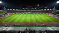 MS T/L Shot of Playing soccer in Seongnam soccer field at sunset / Seongnam, Kyonggi-Do Province, South Korea