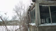 Shot of porch windows on an abandoned house