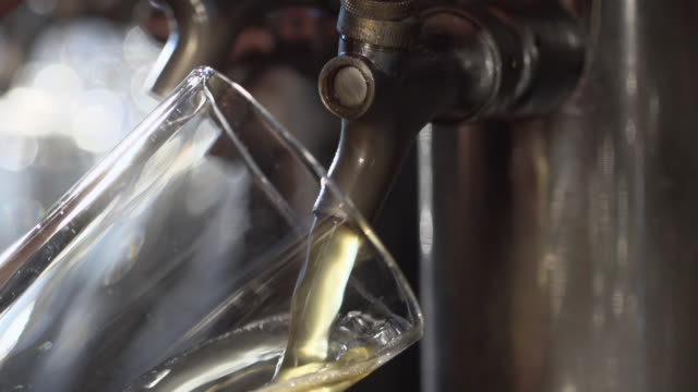 ECU SLO MO Shot of pouring beer on tap into glass / Seattle, Washington, United States
