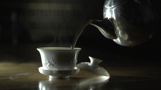 Shot of pouring tea into a Tea Cup