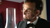CU ZI ZO Shot of President Abraham Lincoln sitting at desk and writing / Clear Spring, Maryland, United States