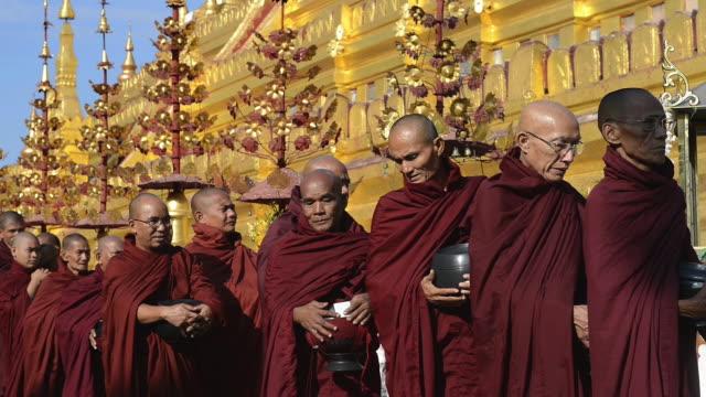 CU Shot of Procession of Buddhist monks at Full Moon Festival in Shwezigon Pagoda / Bagan, Mandalay Division, Myanmar