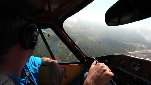 MS POV Shot of profile pilot flying aero car over city / Kissimmee, Florida, United States