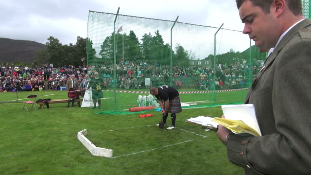 MS Shot of Putting Stone at braemar royal highland games / Braemar, Aberdeenshire, Scotland