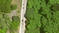 MS AERIAL TS Shot of rack railroad tracks with pedestrians / Kalavryt, Peloponnese, Greece