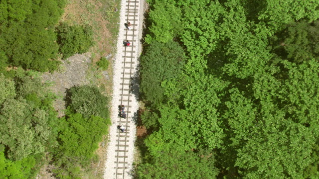 MS AERIAL TS Shot of rack railroad tracks with pedestrians / Kalavryt, Peloponnese, Greece