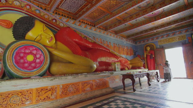 MS Shot of Reclining Buddha statue in Isuruminiya Rock Temple / Anuradhapura, North Central Province, Sri Lanka